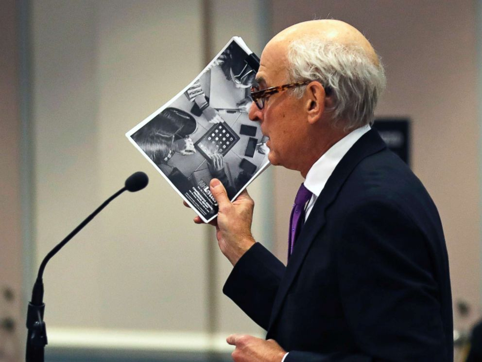 PHOTO: Attorney Steven M. Gordon, who represents lottery winner Jane Doe, holds up an annual report from the New Hampshire Lottery during a hearing in the Jane Doe v. NH Lottery Commission case in Nashua, N.H., Feb. 13, 2018.