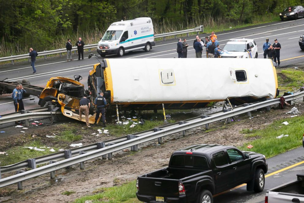 PHOTO: Emergency personnel work at the scene of a school bus and dump truck collision, injuring multiple people, on Interstate 80 in Mount Olive, N.J., on May 17, 2018.