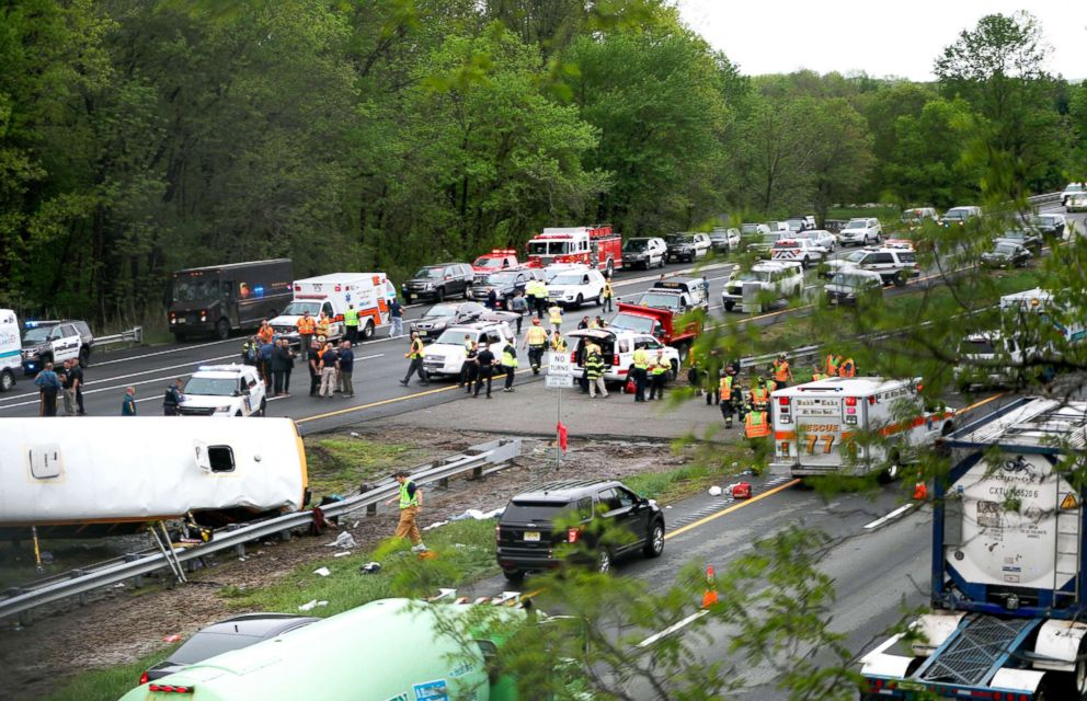 PHOTO: Emergency personnel work at the scene of a school bus and dump truck collision on Interstate 80 in Mount Olive, N.J., May 17, 2018.