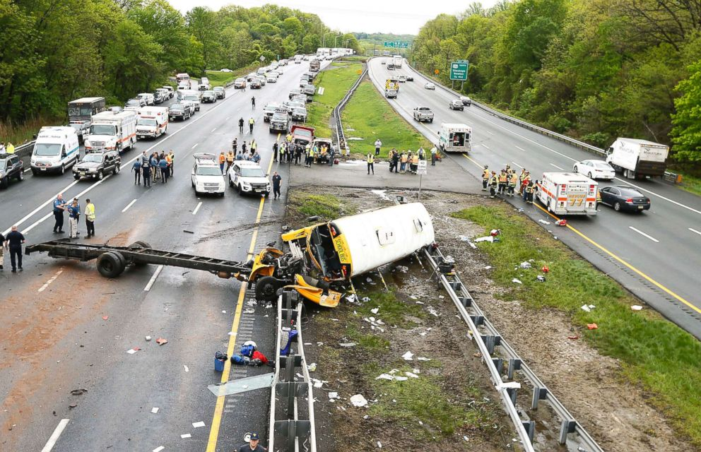 PHOTO: Emergency crews respond to the scene of a crash between school bus carrying middle school students and dump truck on a New Jersey highway, May 17, 2018.