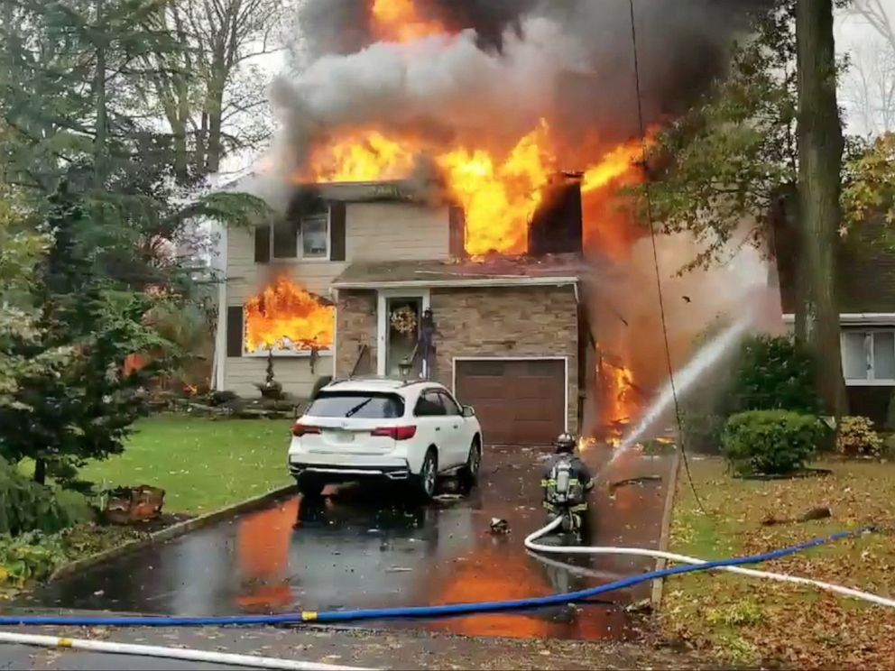 PHOTO: A house is seen on fire after a plane crashed into it in Colonia, New Jersey, Oct. 29, 2019.
