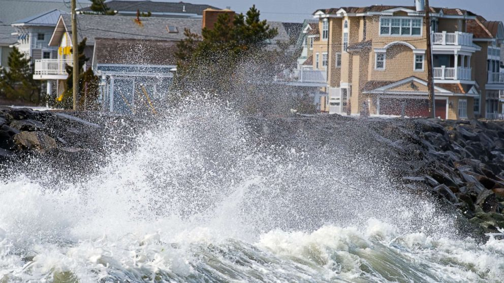 In this undated stock photo, waves crash against the seawall in Avalon, N.J.
