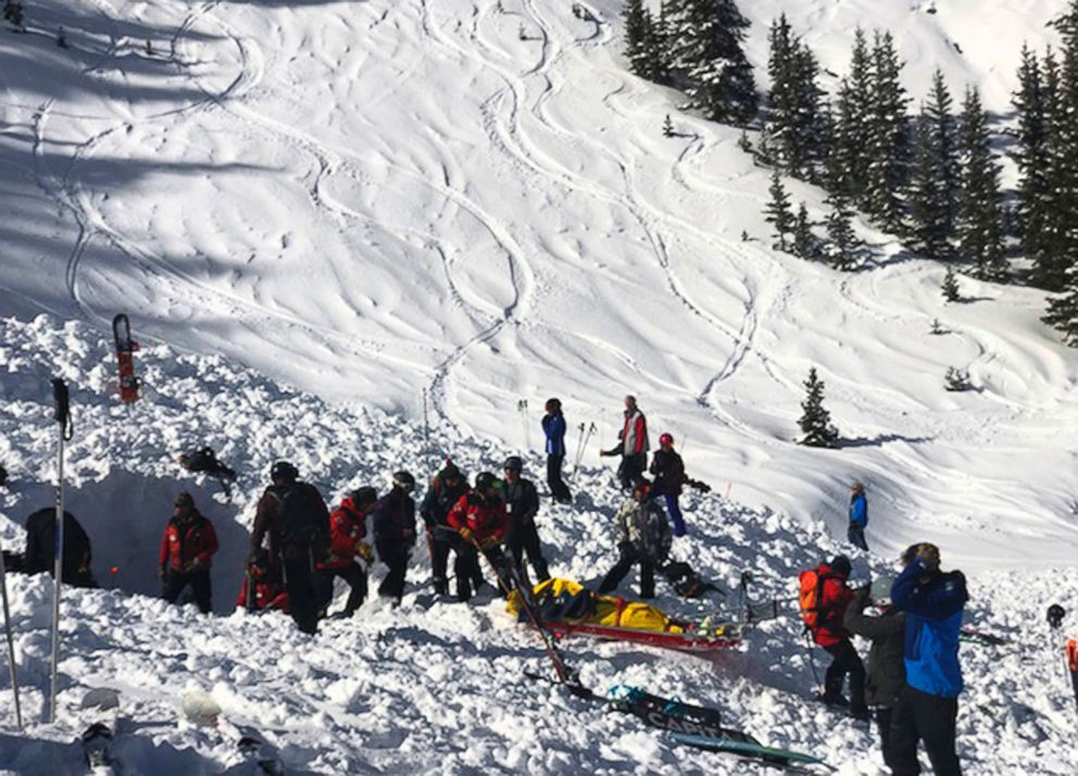 PHOTO: People search for victims after an avalanche near the highest peak of Taos Ski Valley, one of the biggest resorts in New Mexico, Jan. 17, 2019.
