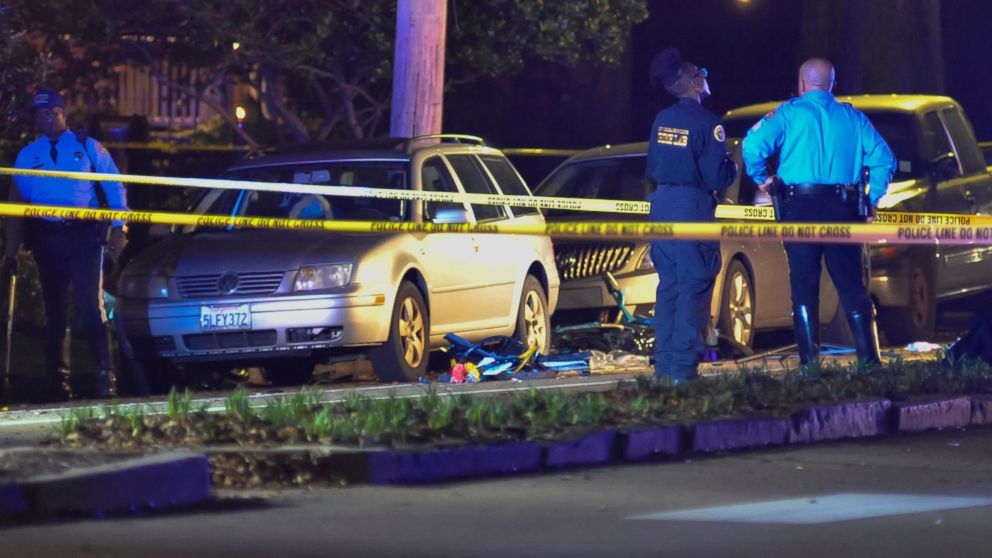 Two damaged bicycles lay in the street as New Orleans Police Department officers respond to a