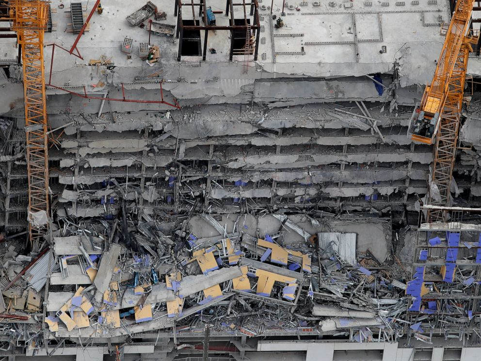 New Orleans sets blasts to clear cranes at hotel collapse site
