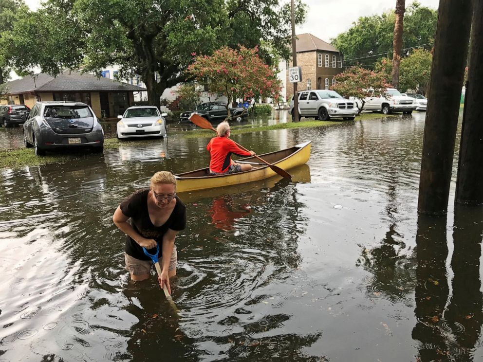 PHOTO: People cope with the aftermath of severe weather in the Broadmoor neighborhood in New Orleans, Wednesday, July 10, 2019.