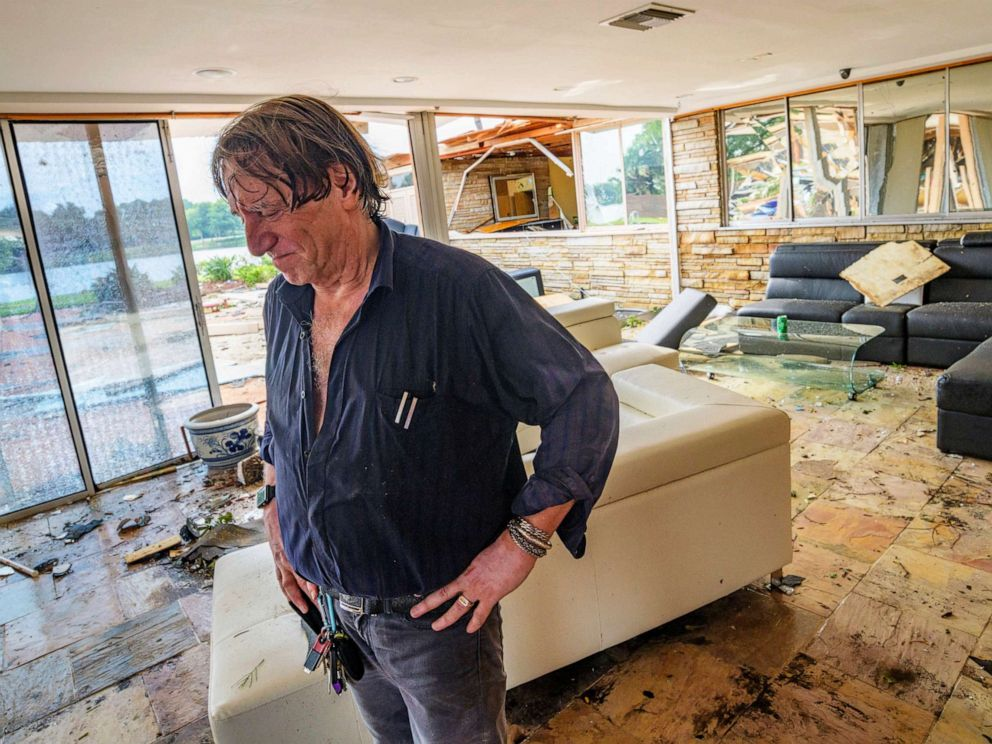 PHOTO: Eric Ehlenberger pauses as he goes through his damaged home in New Orleans on July 10, 2019, following a storm that swamped the city and paralyzed traffic.