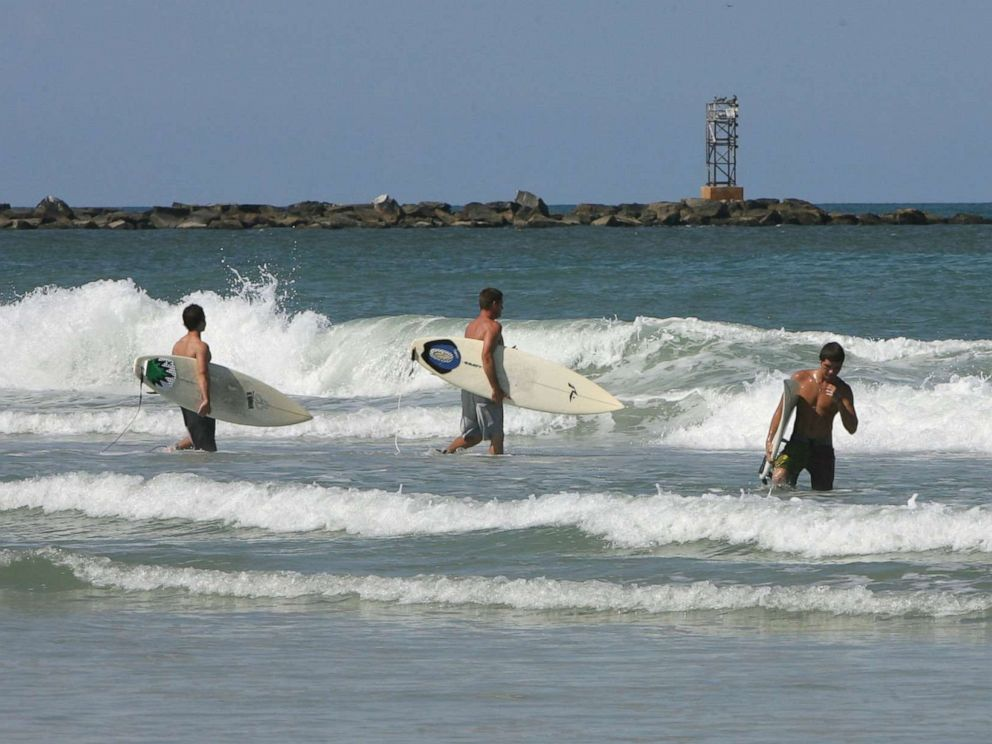 PHOTO: Surfers hit the waves at New Smyrna Beach in Florida, Aug. 29, 2007.
