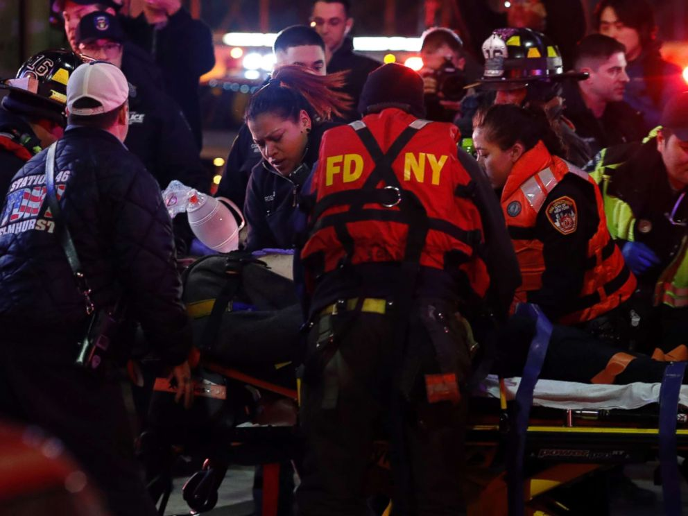 PHOTO: A helicopter crash victim is transferred by Fire Department officers at 34th Street Ferry Terminal in Manhattan, March 11, 2018.