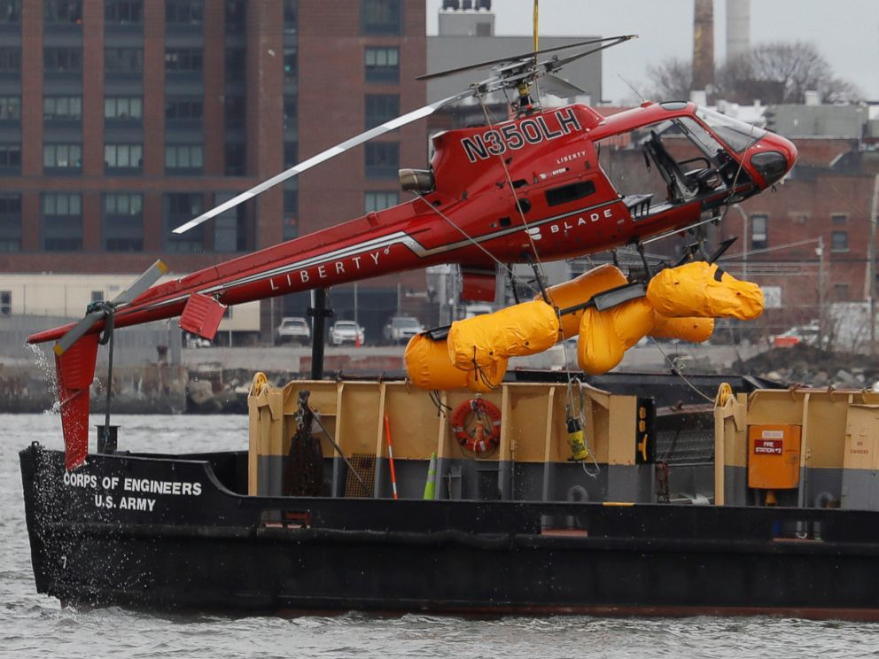 PHOTO: The wreckage of a chartered Liberty Helicopters helicopter that crashed into the East River is hoisted from the water in New York, March 12, 2018.