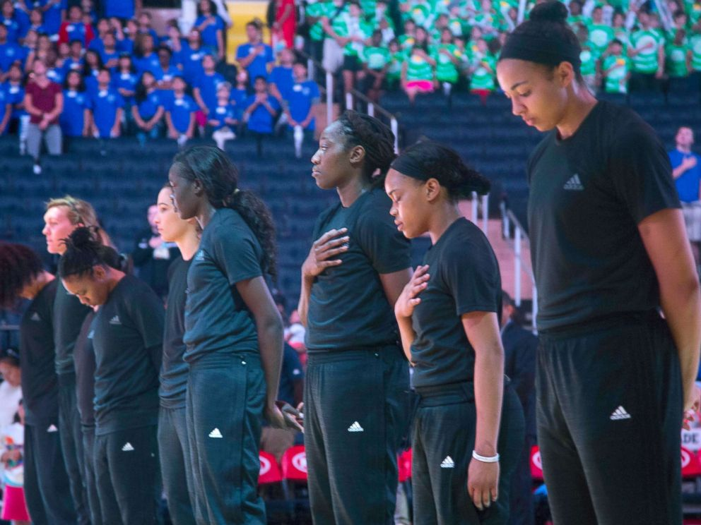 PHOTO: Members of the New York Liberty basketball team stand during the playing of the Star Spangled Banner prior to a game against the Atlanta Dream, July 13, 2016, in New York.