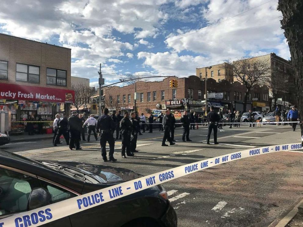 PHOTO: Police officers stand behind a cordon tape at the scene where New York police officers shot to death a black man who pointed a metal pipe at them, in the borough of Brooklyn, N.Y., April 4, 2018, in this picture obtained from social media.