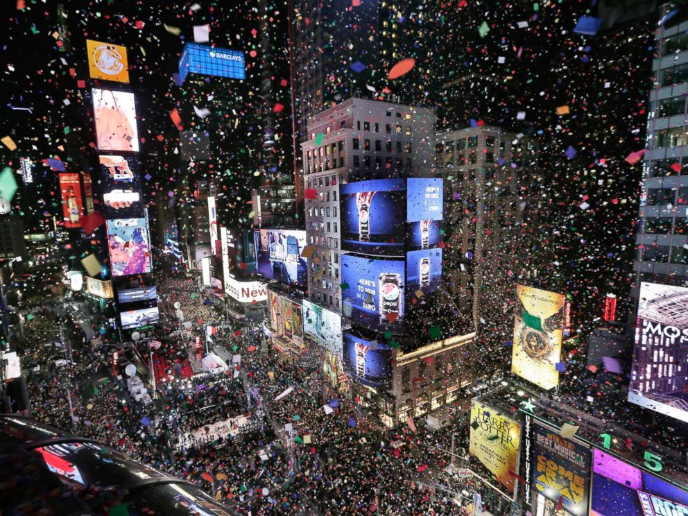 PHOTO: Confetti drops over the crowd as the clock strikes midnight during the New Years celebration in Times Square, New York, Jan. 1, 2018.