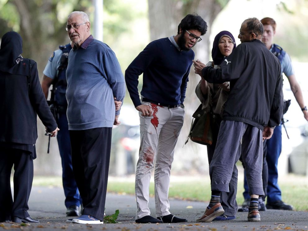 PHOTOS: People are standing across the road from the mosque in the heart of Christchurch, New Zealand, on March 15, 2019.