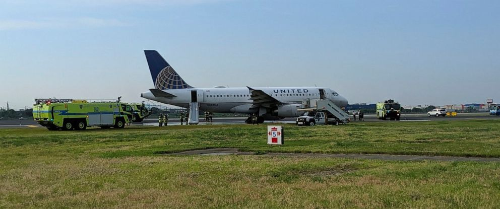 PHOTO: This photo provided by John Murray shows a United flight sitting on the runway after making an emergency landing on June 29, 2019 at Newark Liberty Airport in Newark, N.J.