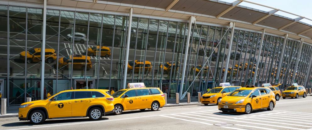 PHOTO: Taxicabs are reflected in the windows of Newark International Airport as they gather to pick up travelers, Newark, N.J. in July 2016.