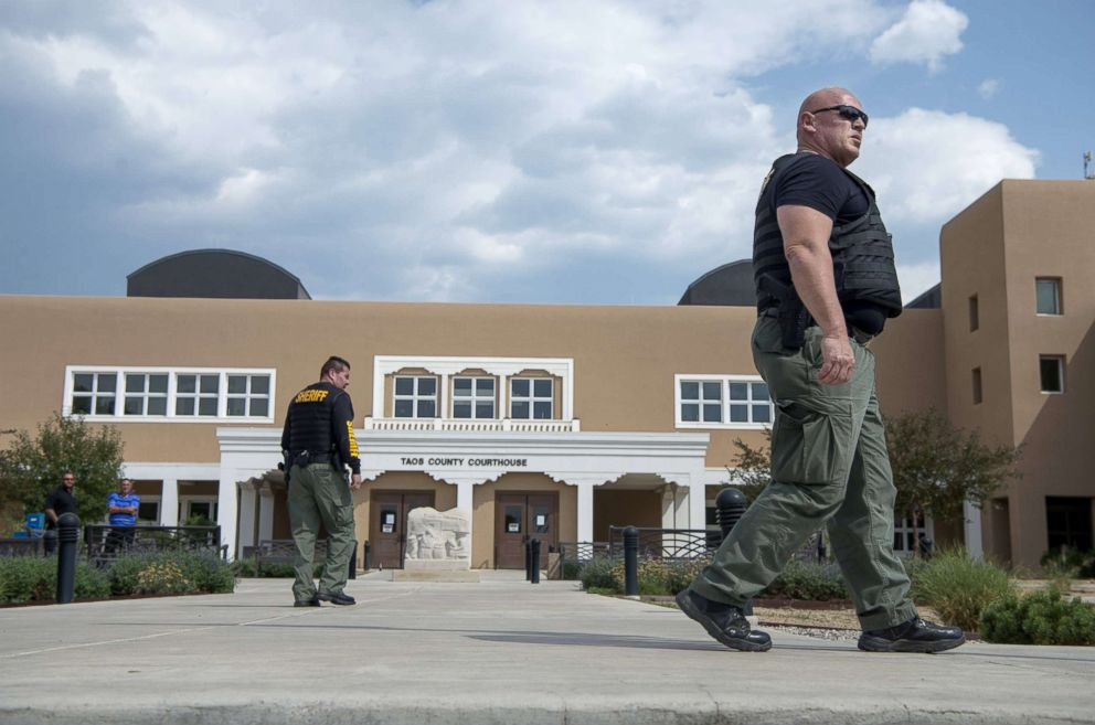 Sheriffs Officers patrol outside the Taos County Courthouse after it was closed due to security reasons. Judge Sarah Backus has received several threats since ordering the release of suspects arrested in a compound on the north side of the county.