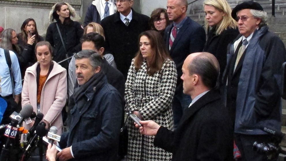 Ian Hockley, front left, father of Dylan Hockley, one of the children killed in the 2012 Sandy Hook Elementary School shooting, speaks outside the Connecticut Supreme Court, Nov. 14, 2017, in Hartford, Conn. The court held an appeal hearing on whether gun maker Remington Arms should be held liable for the 2012 school massacre at Sandy Hook Elementary School in Newtown, Conn.