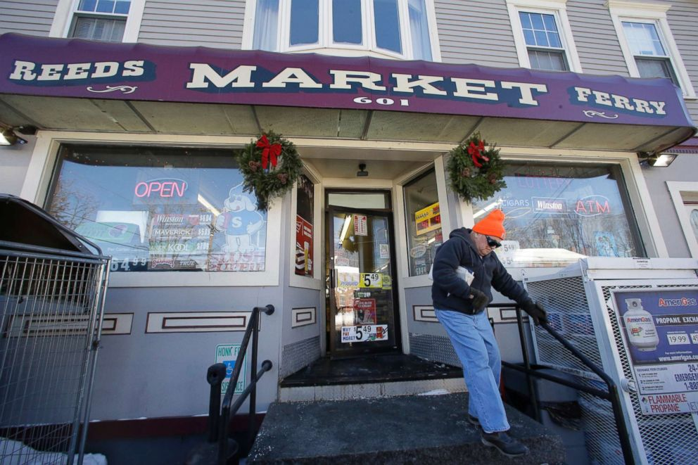 PHOTO: A customer departs Reeds Ferry Market convenience store, Jan. 7, 2018, in Merrimack, N.H. A lone Powerball ticket sold at this convenience store matched all six numbers and will claim a $570 million jackpot.