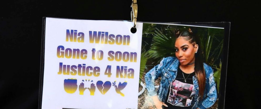 Images of Nia Wilson, who was fatally stabbed at a BART Station, are worn by a family member, July 25, 2018, outside a courtroom in Oakland, Calif, where a paroled robber was charged with Wilsons murder and the attempted murder of her sister.