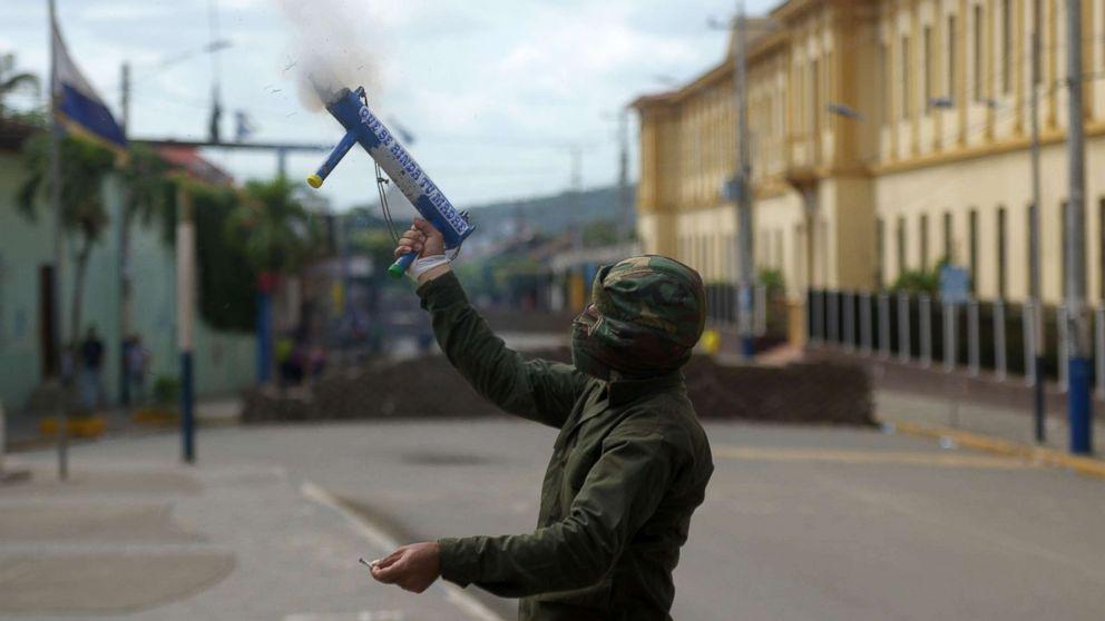 An anti-government demonstrator fires a homemade mortar in the Monimbo neighborhood in Masaya, Nicaragua, July 11, 2018.