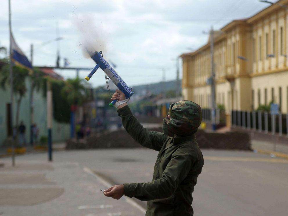 PHOTO: An anti-government demonstrator fires a homemade mortar in the Monimbo neighborhood in Masaya, Nicaragua, July 11, 2018.