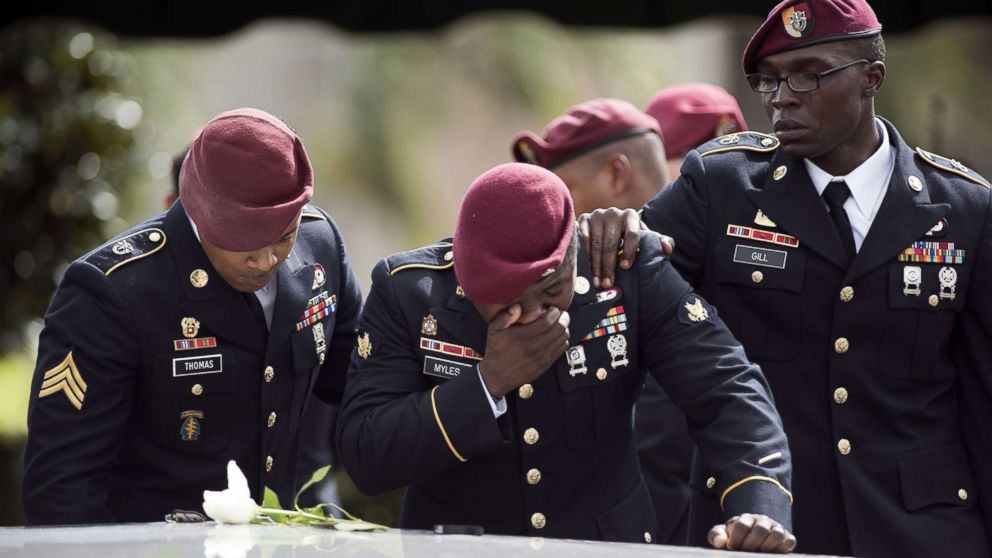 Members of the Special Forces cry at the tomb of Army Sgt. La David Johnson at his burial service in the Memorial Gardens East cemetery, Oct. 21, 2017 in Hollywood, Fla. Sgt. Johnson and three other U.S. soldiers were killed in an ambush in Niger on October 4.