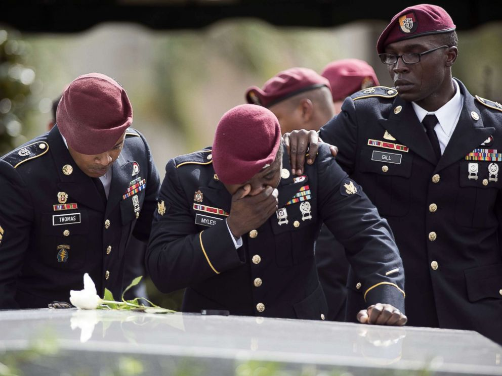 PHOTO: Members of the Special Forces cry at the tomb of Army Sgt. La David Johnson at his burial service in the Memorial Gardens East cemetery, Oct. 21, 2017 in Hollywood, Fla. Sgt. Johnson and three other U.S. soldiers were killed in an ambush in Niger.