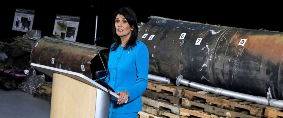 """PHOTO: U.S. Ambassador to the United Nations Nikki Haley briefs the media in front of remains of Iranian """"Qiam"""" ballistic missile provided by Pentagon at Joint Base Anacostia-Bolling in Washington, Dec. 14, 2017."""