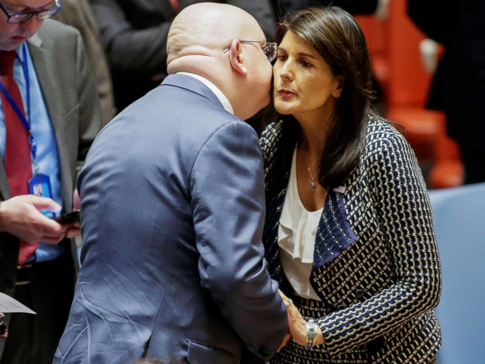 PHOTO: United States Ambassador to the United Nations Nikki Haley greets Russian Ambassador to the United Nations Vasily Nebenzya before the United Nations Security Council meeting on Syria at the U.N. headquarters in New York, April 13, 2018.