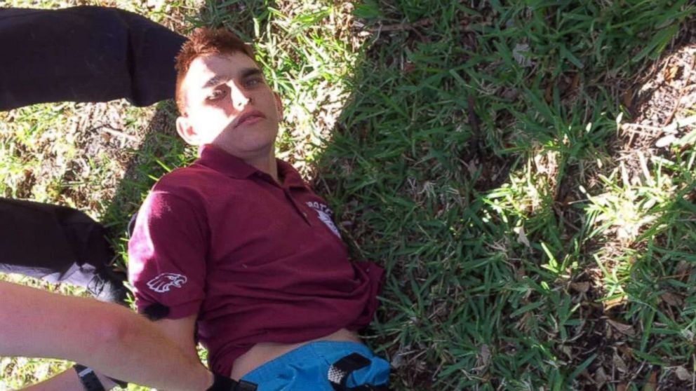 Nikolas Cruz is placed into handcuffs by police near Marjory Stoneman Douglas High School following a mass shooting in Parkland, Fla., Feb. 14, 2018.