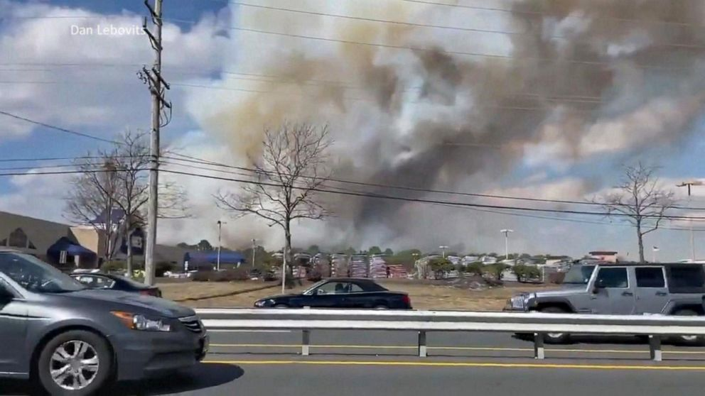 PHOTO: Firefighters in Ocean County, New Jersey work to contain a massive forest fire that burned 170 acres, damaged nearby structures and seriously injured a firefighter on March 14, 2021.
