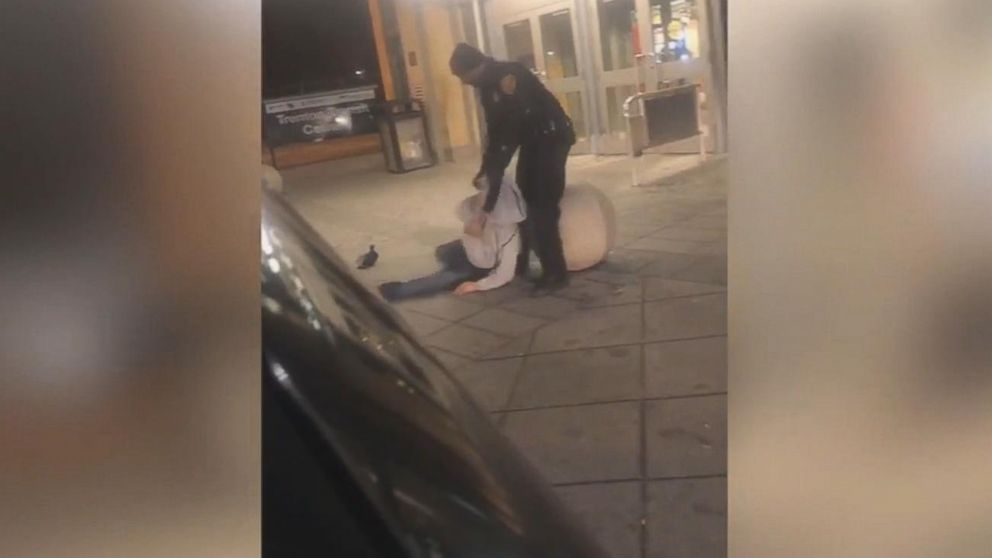 A New Jersey Transit police officer is under investigation after a cellphone video surfaced showing him apparently dragging, cursing and hitting a man who appeared to be passed out in front of the Trenton Transit Center, March 9, 2019.