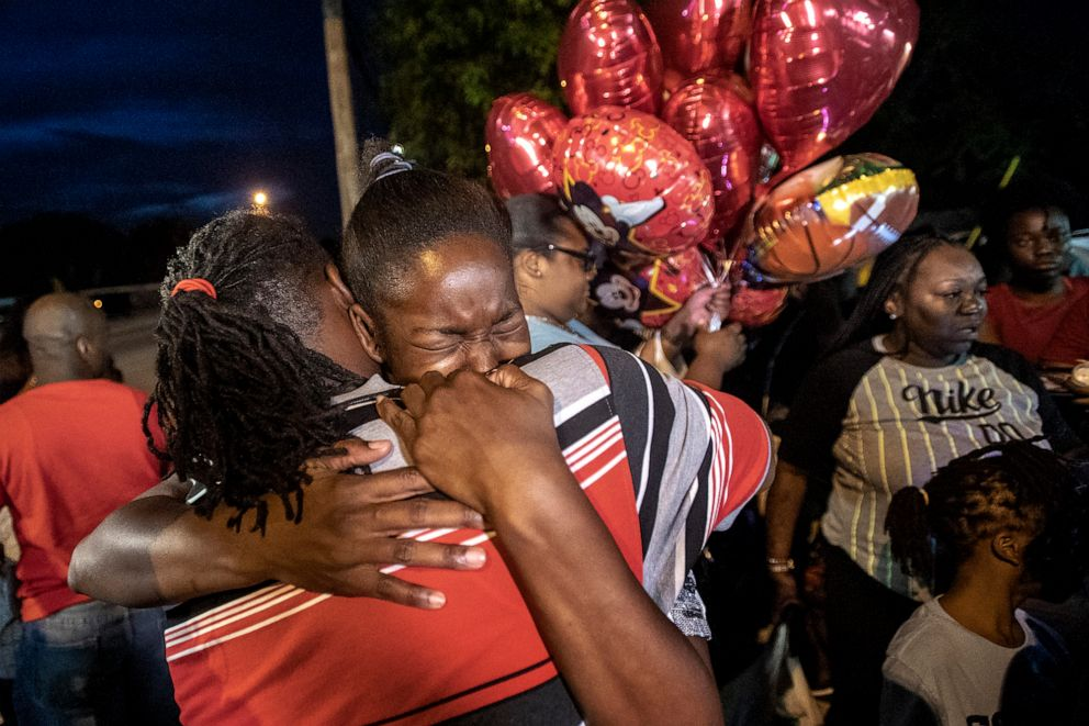 PHOTO: Chanese Sneed, the mother of Noah Sneed hugs Noahs father Tony Bell during a gathering to honor his life with a candlelight memorial in front of the Ceressas Daycare & Preschool Center, July 30, 2019, in Oakland Park, Fla.