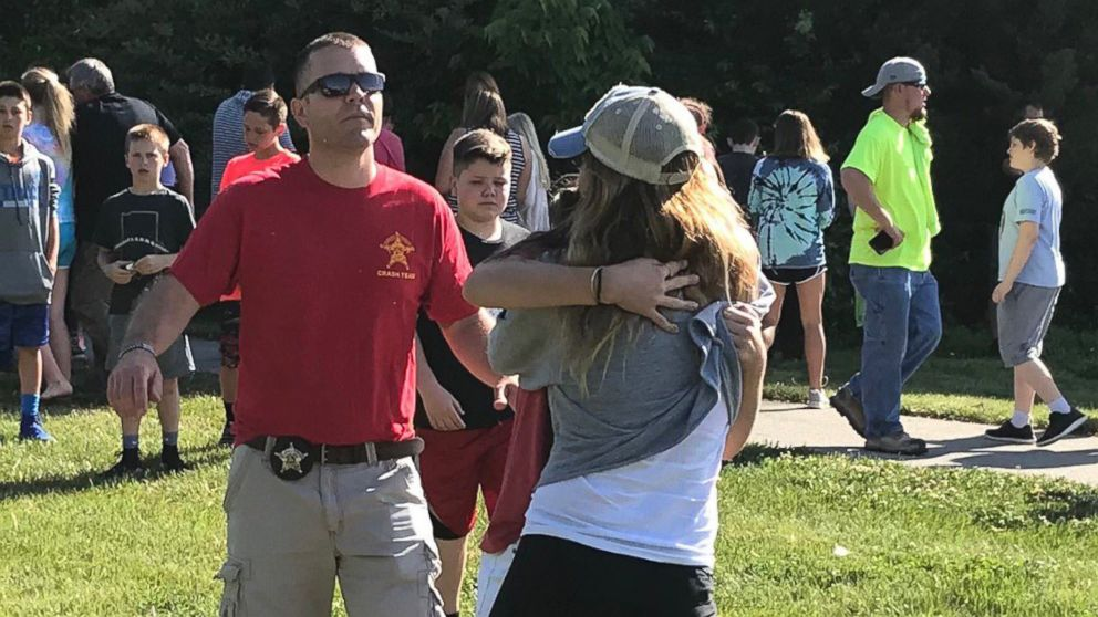People hug after a shooting at Noblesville West Middle Scholl in Noblesville, Ind., May 25, 2018.