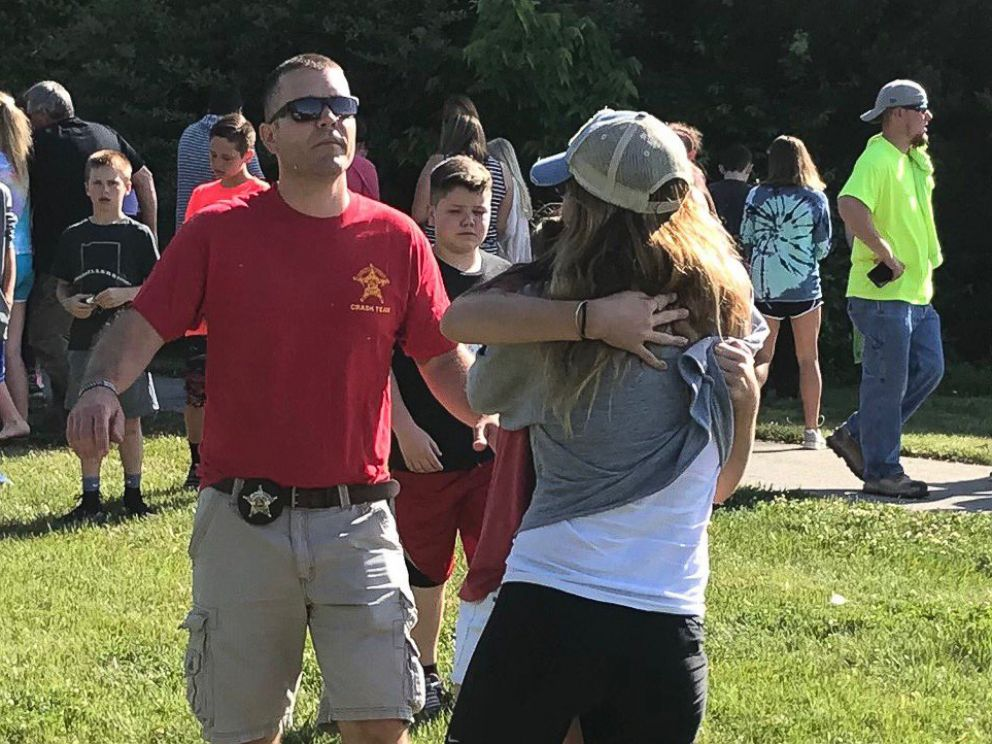 PHOTO: People hug after a shooting at Noblesville West Middle Scholl in Noblesville, Ind., May 25, 2018.