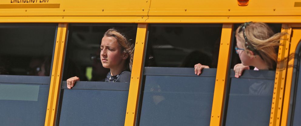 PHOTO: Girls look out from a school bus after a shooting at Noblesville West Middle Scholl in Noblesville, Ind., May 25, 2018.