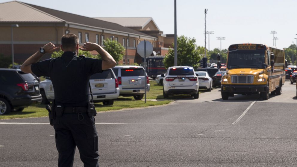 An officer directs traffic following a shooting at Noblesville West Middle School in Noblesville, Ind., May 25, 2018.