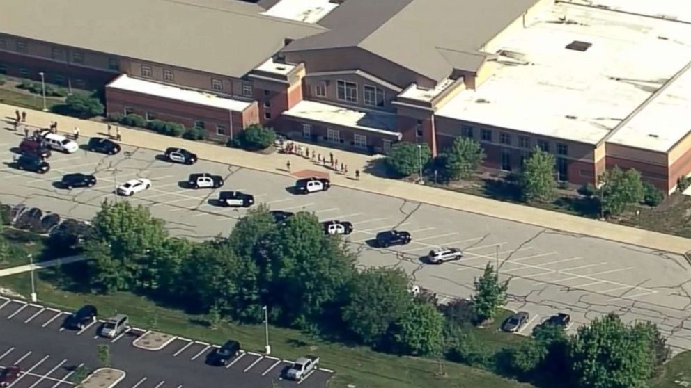 Students stream out of Noblesville West Middle School in Noblesville, Ind., after reports of a shooting, May 25, 2018.
