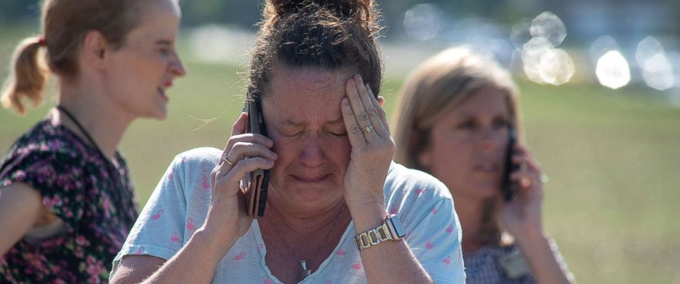 PHOTO: Instructional Assistant Paige Rose reacts outside Noblesville West Middle School after a shooting at the school on May 25, 2018 in Noblesville, Ind.