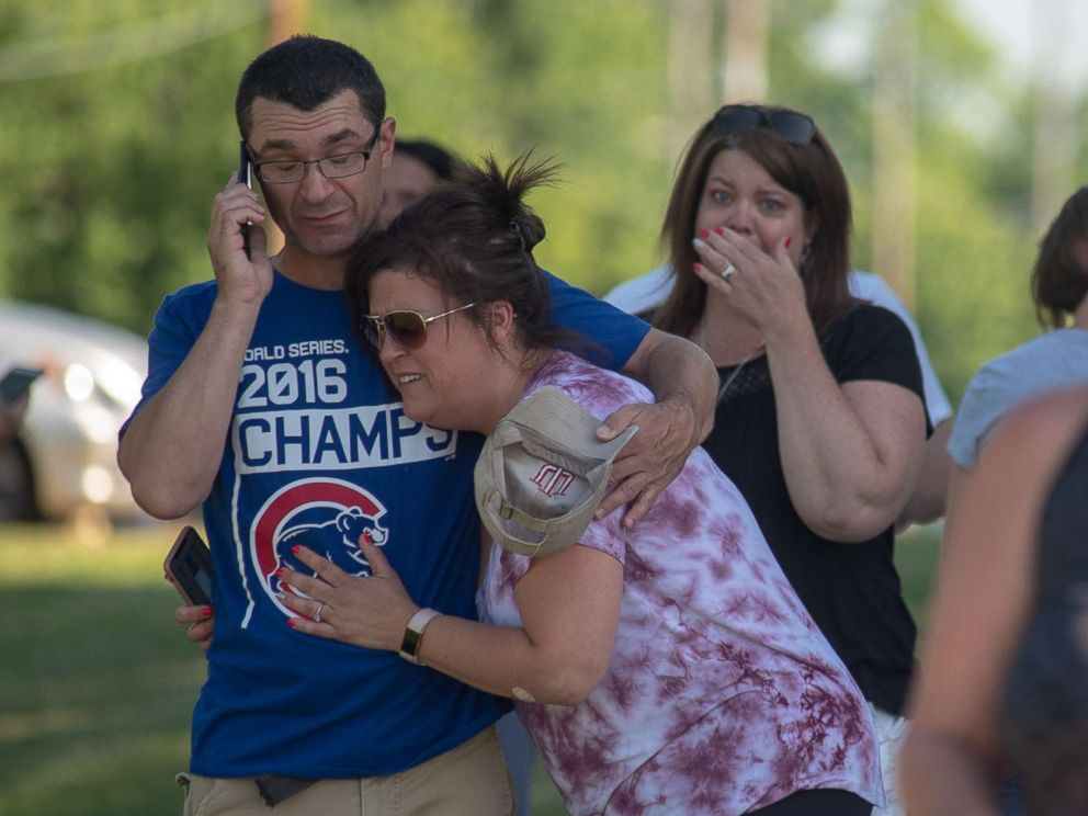 PHOTO: Parents comfort each other as they wait outside Noblesville West Middle School after a shooting on May 25, 2018, in Noblesville, Ind.