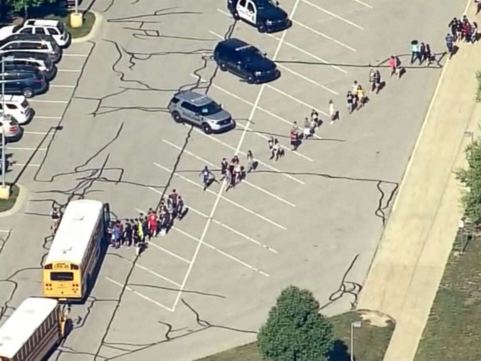 PHOTO: Students are loaded onto school buses at Noblesville West Middle School in Noblesville, Ind., after reports of a shooting, May 25, 2018.
