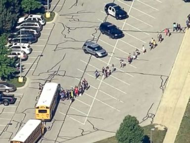 2 hospitalized after middle school shooting, suspect in custody