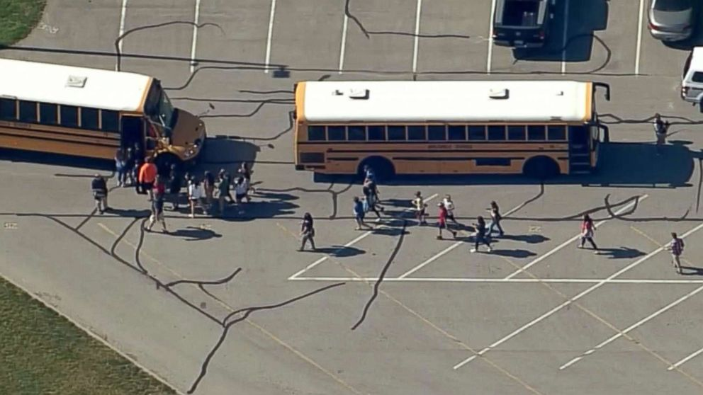 Students are loaded onto school buses at Noblesville West Middle School in Noblesville, Ind., after reports of a shooting, May 25, 2018.