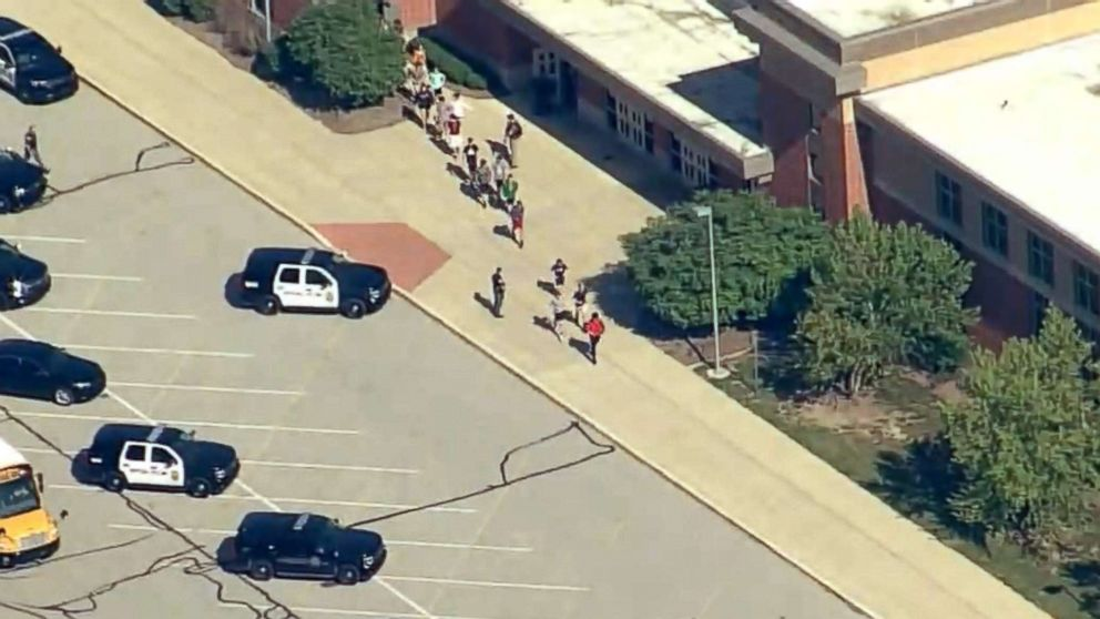 People stream out of Noblesville West Middle School in Noblesville, Ind., after reports of a shooting, May 25, 2018.