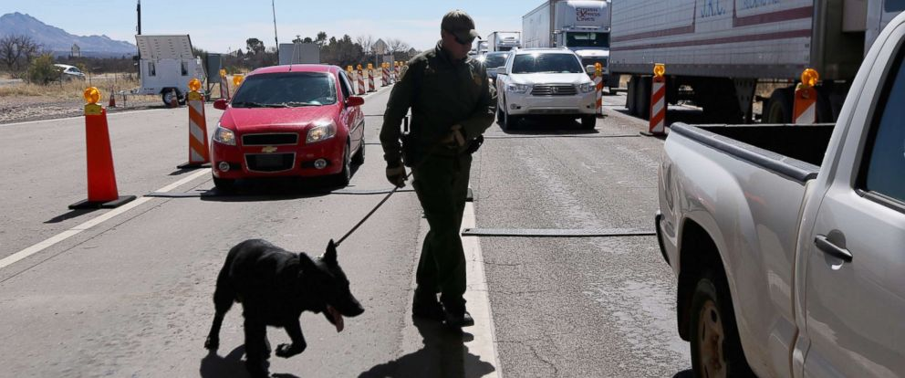 PHOTO: A U.S. Border Patrol agent and drug sniffing German Shepherd prepare to search vehicles for drugs at a checkpoint near the U.S. Mexico border on Feb. 26, 2013 north of Nogales, Ariz.