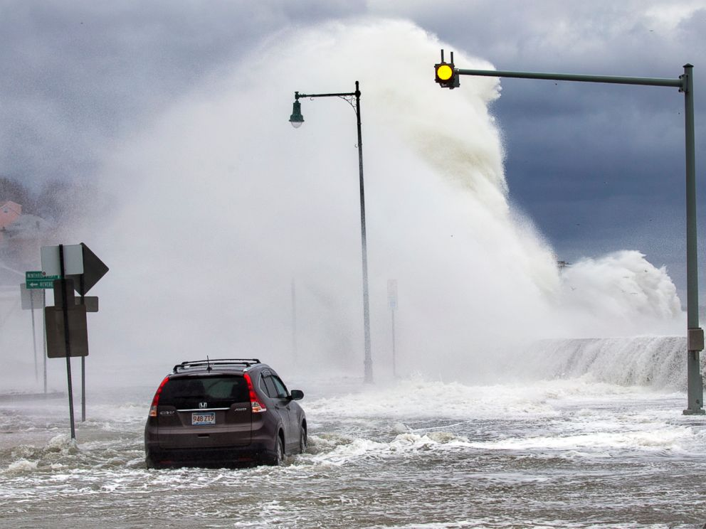 PHOTO: A car sits stuck in the water as the high tide pushes up and over the seawall at Short Beach, on the Revere/Winthrop line, March 3, 2018, in Winthrop, Mass.