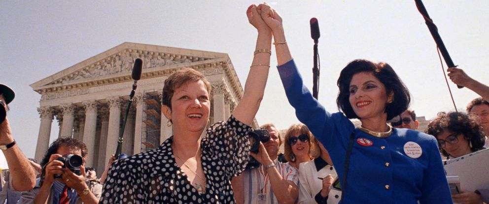 PHOTO: In this Wednesday, April 26, 1989 file photo, Norma McCorvey, Jane Roe in the 1973 court case, left, and her attorney Gloria Allred hold hands as they leave the Supreme Court building in Washington.