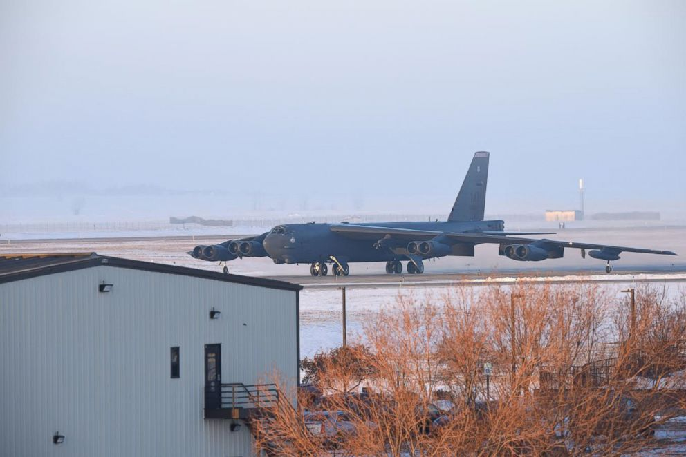 PHOTO: A U.S. Air Force B-52 bomber sits on the runway at Minot Air Force Base in North Dakota during a cold snap in January 2019.