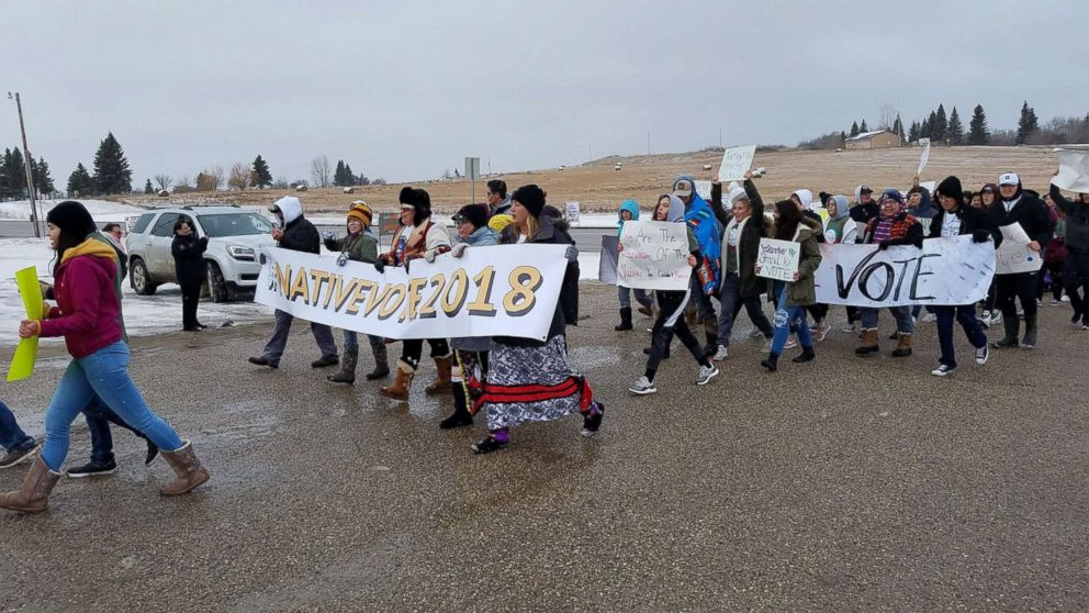 Native American youth from the Turtle Mountain band of the Chippewa marched from Belcourt High School to the Knights of Columbus polling place on the reservation near Belcourt, N.D., Nov. 6, 2018.
